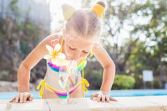 Toddler girl with cocktail in tropical beach pool Stock Photography