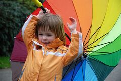 Toddler girl with colorful umbrella