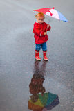 Toddler girl with colorful umbrella on rainy day Stock Photography