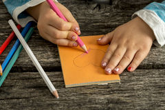 Toddler girl colouring a heart shape Stock Photography