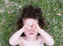 Toddler girl covering eyes from above Royalty Free Stock Photo