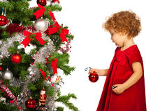 Toddler girl decorate tree Royalty Free Stock Image