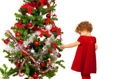 Toddler girl decorate Xmas tree Stock Photo