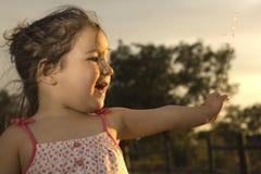 Toddler girl on dehesa sunset Stock Image