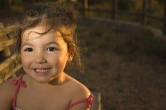Toddler girl on dehesa sunset Royalty Free Stock Image