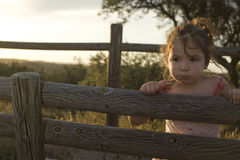 Toddler girl on dehesa sunset Royalty Free Stock Photography
