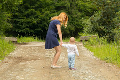 Toddler girl discovering the outdoors Stock Images