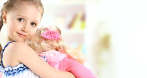 Toddler girl with doll. On a white background royalty free stock images