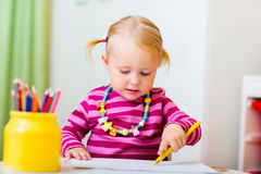 Toddler girl drawing Royalty Free Stock Photography