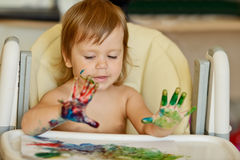 Toddler girl is drawing Royalty Free Stock Photos