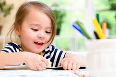 Toddler girl drawing and doing crafts Royalty Free Stock Image