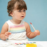 Toddler girl drawing with pencils Royalty Free Stock Images