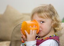 Toddler Girl Drinking From A Cup Royalty Free Stock Photo