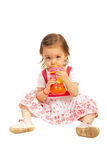 Toddler girl drinking juice Stock Photos