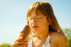 Toddler girl eating ice cream on beach Royalty Free Stock Photo