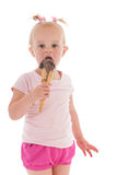 Toddler girl eating ice cream Royalty Free Stock Photography