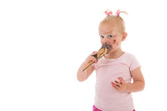 Toddler girl eating ice cream Royalty Free Stock Images