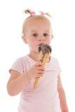 Toddler girl eating ice cream Royalty Free Stock Photos