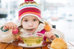 Toddler girl eating Royalty Free Stock Photo