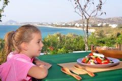 Toddler girl eating tradiotional Mediterranean salad Stock Images