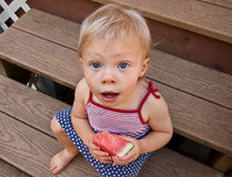 Toddler Girl Eating Watermelon in Summer on Stairs Royalty Free Stock Photo
