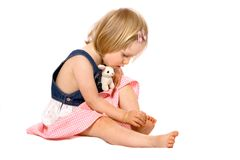 Toddler girl examines her toes Stock Photo