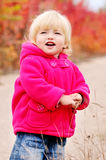 Toddler girl in fall park Royalty Free Stock Photo