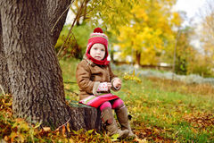 Toddler girl in fall time Royalty Free Stock Photo