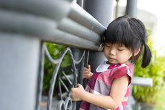 Toddler girl at fence Royalty Free Stock Image