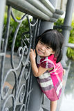 Toddler girl at fence Stock Image