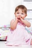 Toddler girl in a festive dress stock photos