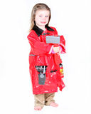 Toddler girl in firefighter costume. With axe on white background Stock Photography