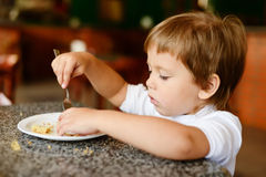Toddler girl with fork Stock Images