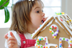 Toddler girl with gingerbread cookie Royalty Free Stock Images