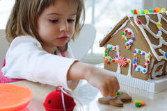 Toddler girl with gingerbread cookie Royalty Free Stock Photography
