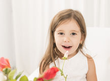 Toddler girl giving flowers to her mom on mother's day Royalty Free Stock Photo