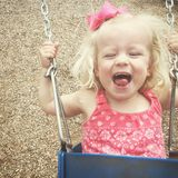 Toddler on swing set royalty free stock photography