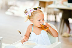 Toddler girl have a breakfast Stock Photos
