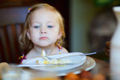 Toddler girl having breakfast Stock Images
