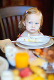Toddler girl having breakfast Royalty Free Stock Image