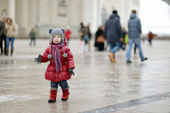 Toddler girl having fun on winter day in a city Royalty Free Stock Image