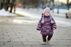 Toddler girl having fun on winter day in a city Royalty Free Stock Photos