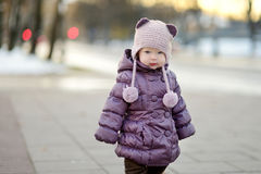 Toddler girl having fun on winter day in a city Stock Photos
