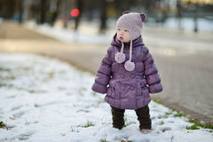 Toddler girl having fun on winter day in a city Royalty Free Stock Images