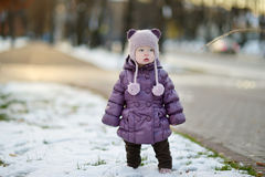 Toddler girl having fun on winter day in a city Royalty Free Stock Photo