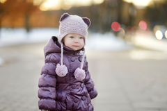 Toddler girl having fun on winter day in a city Stock Image