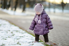 Toddler girl having fun on winter day in a city Stock Images