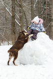 Toddler girl having winter fun on snowy hill with Stock Photography