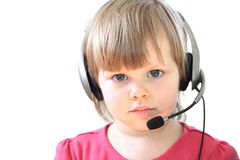 Toddler girl with a headset Stock Photos