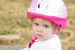 Toddler girl with helmet Stock Image